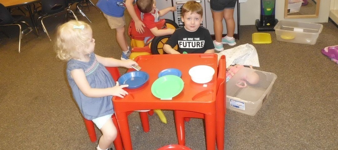 Preschoolers, at our Celina centerbased program, playing together.