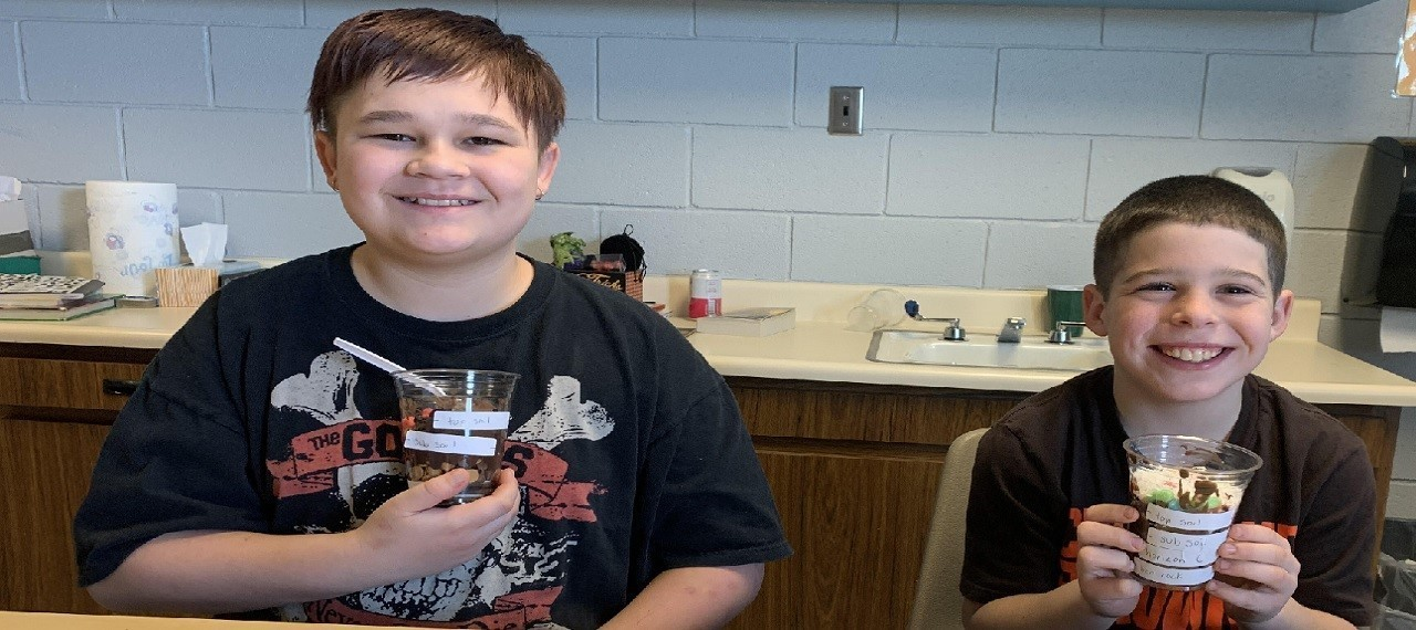 Students at the Community Learning Center create edible soil profiles