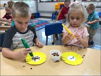 Preschool children working on fine motor skills